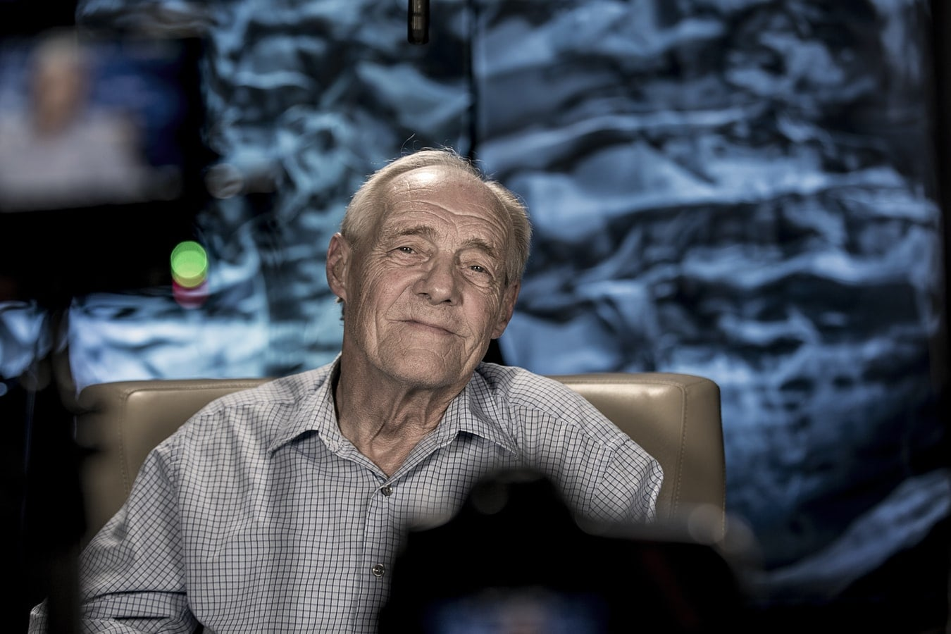 documentary filmmaking old man sitting in front of the camera