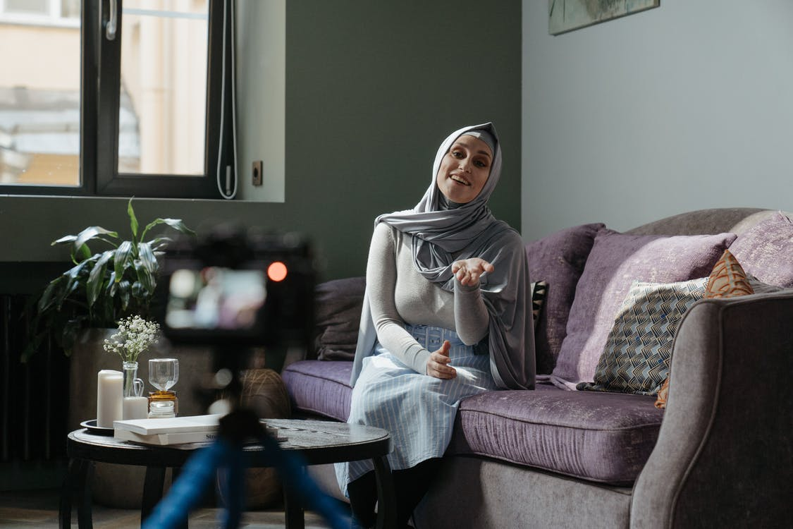 documentary filmmaking woman sitting on a couch being interviewed