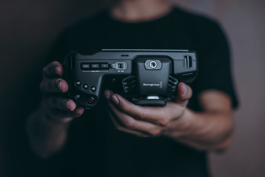 Person Holding BlackmagicDesign Pocket Cinema Camera 4k